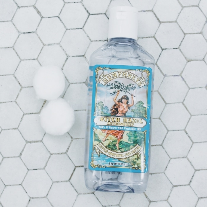 A bottle of witch hazel used after removing the hydrating natural facial recommended by The Conscious Collective