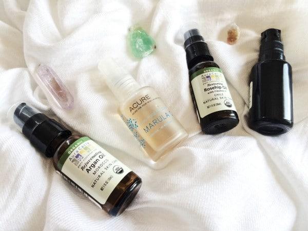 four bottles of Nourishing Oils