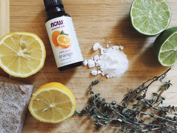 Natural cleaning products on cutting board