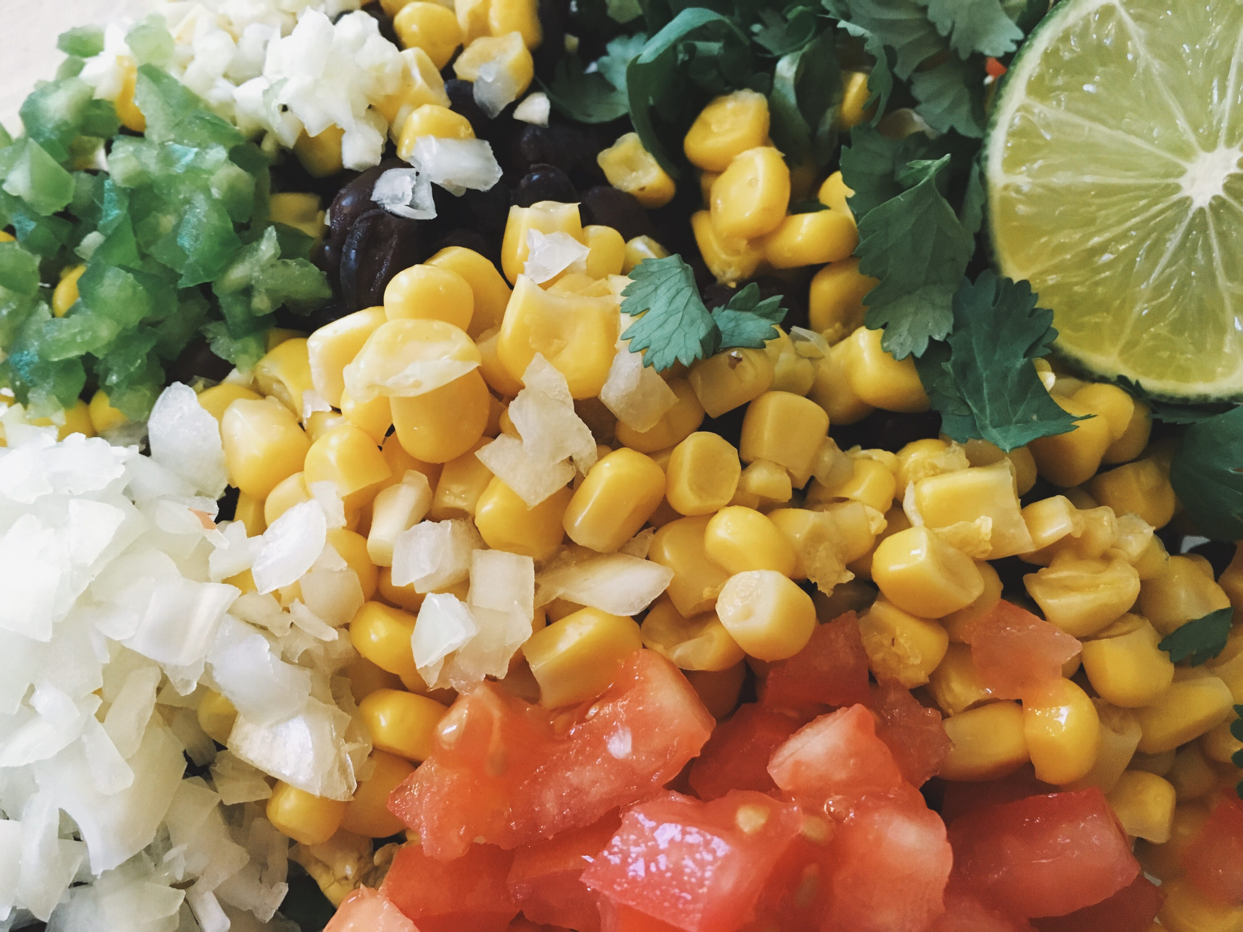 Chopped jalepeno, onion, garlic, tomato, corn and cilantro with lime for black bean and corn salsa