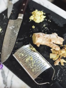 grated ginger on cutting board